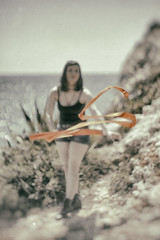 Red Ribbon Baby (O9k) Tags: sea cliff girl canon bokeh sony dancer ribbon fl 12 58mm sitges muted alpha7