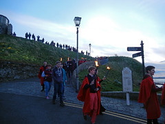 Gaudie seen from the Shorehead, 2016 (Dunnock_D) Tags: road uk blue red sky green walking fire scotland holding unitedkingdom fife britain path hill crowd flame torch lamppost standrews signpost procession gown gowns pends grasss gaudie torchlit shorehead