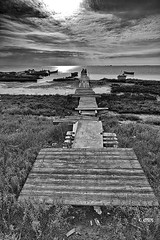 PATHWAY TO THE HORIZON (kkitsos) Tags: ocean wood morning light sea sky blackandwhite sun fish reflection nature water monochrome clouds contrast out landscape grey dawn coast pier boat wooden moss twilight fishing fisherman marine village waterfront outdoor jetty air horizon country perspective tranquility atmosphere scene quay greece vision maritime wharf thessaloniki gutter grayscale seafront overlook bog stillness tone prospect timeless daybreak quayside macedonian makedonia seaborne kalochori  macedoniagreece nikonflickraward peacefulnessline