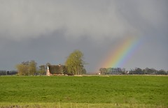 End of the rainbow (Frhtau) Tags: cloud tree field rain weather rural germany deutschland countryside spring rainbow view time farm country feld wolken bow allemagne bauernhof hof regenbogen wetter niedersachsen phnomen