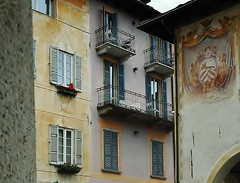 old facades (SM Tham) Tags: windows italy buildings painting square town chairs furniture facades shutters balconies townhall balustrades wallmural lakeorta italianlakes planterboxes ortasangiulio piazzamotta