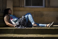 Languid Summer (Leanne Boulton) Tags: life street city uk blue light sleeping shadow portrait people urban woman sunlight color colour detail texture face tattoo architecture female 35mm canon scotland living mood shadows natural humanity outdoor expression glasgow candid columns culture streetphotography streetlife scene human shade 7d siesta napping resting feeling lying society tone facial candidstreetphotography
