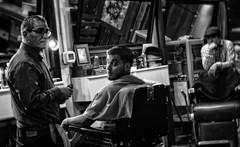 Late Night at the Barbershop (Anne Worner) Tags: street blackandwhite bw man men monochrome hat lensbaby mono mirror frames lowlight nikon sitting candid latenight f16 indoors surprised strongcontrast barberchair shrt d7000 barberbarbershop anneworner velvet56