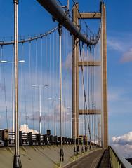 Metal under tension (chaotic river) Tags: bridge blue england sky suspension unitedkingdom steel cable gb humber bartonuponhumber
