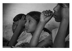 concentration (handheld-films) Tags: school people blackandwhite india students monochrome portraits children reading concentration lowlight education faces classroom indian group documentary class portraiture rajasthan languages reportage literacy schooling villageschools