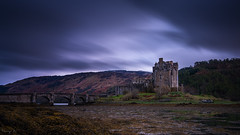 Eilean Donan Castle (Tony N.) Tags: longexposure bridge trees bw mountains castle film clouds forest montagne movie scotland highlands europe stones pierre highlander ciel pont lowtide chateau nuages foret arbre vanguard montagnes ecosse dornie maréebasse poselongue d810 nd110 tonyn nikkor1635f4 tonynunkovics