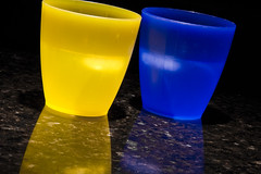 Half Full - Half Empty (brucetopher) Tags: blue light reflection ice cup water yellow catchycolors glow cups blueandyellow