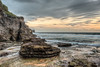 Did that fall from up there? (JustAddVignette) Tags: ocean morning sea sky panorama cliff seascape beach clouds landscapes early twilight sand rocks waves sydney australia east newsouthwales headland firstlight northernbeaches seawater beforedawn cloudysunrise warriewoodbeach