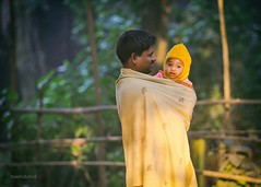 Dad Life (Numbplug) Tags: morning winter shadow baby sunlight cold cute love nature parents countryside babies father country warmth covered heat bangladesh dhamrai