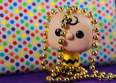 Big Head Chuck One Object Photo Challenge - day 40 - Too Much Fun at Mardi Gras #BigHeadChuck (Soapbox Girl (Carol Anne)) Tags: toy toys actionfigure gold beads colorful purple peanuts polkadots actionfigures charliebrown mardigras multicolor polkadot funko oneobject theyearofcharliebrown oneobjectchallenge bigheadchuck oneobjectphotography