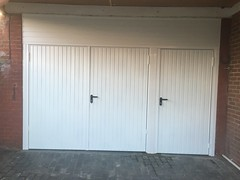 Large garage opening I filled with Garador side opening doors and a personel door. Meads. December 2015