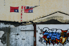 Signs and Symbols (Bob Hawley) Tags: art buildings outdoors graffiti asia paintings taiwan kaohsiung protesting zuoying nikon50mmf14 nikond7100 rocflags
