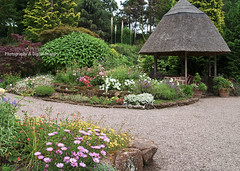 THATCHED SUMMER HOUSE IN THE ROCK GARDEN (David~Preston) Tags: uk flowers england cheshire therockgarden nessbotanicgardens thewirral thatchedsummerhouse