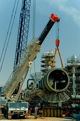 Lifting begins (algimantas_tirlikas) Tags: chimney building work construction crane tools montage pipeline cistern rafinery mounter