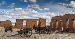 Relics at the Fort (Fred Moore 1947) Tags: newmexico clouds us unitedstates santafetrail fortunion watrous landscapenewmexicowagon