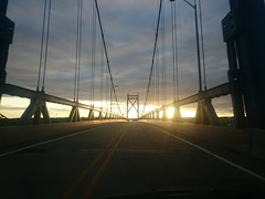 Bridge (modestmoze) Tags: road travel bridge blue trees sunset summer sky usa white green lines car yellow metal clouds grey evening moving driving going 2015