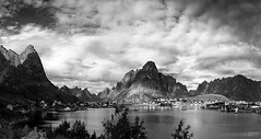 have you ever stood and stared, marvelled at its beauty? (lunaryuna (off to Iceland for 2 weeks)) Tags: sky bw panorama seascape mountains monochrome beauty weather norway islands coast blackwhite village lunaryuna reine lightshadow cloudscape urbanlandscape lofotenislands moskenesoya reinefjorden lightmood lofotenwall