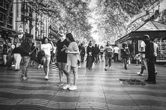 ... (Gabriel M.A.) Tags: barcelona street bw spain grain olympus cropped catalunya lasramblas 24mm 12mm zuiko f28 f4 omd 2x3 vendors 4x6 em5 1240mm olympusmzuikopro1240mmf28