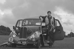 IMG mono-  Pilot and Hillman Minx car, watching. (Beth Hartle Photographs2013) Tags: vintage wwii reenactment raf aircrafts aircrew hillmanminx royalairforce naffiwagon