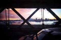 5:04pm J train. (Juliet everywhere) Tags: nyc newyorkcity bridge sunset sky newyork skyline clouds subway sony wideangle williamsburg 16mm sonyalpha sonynex