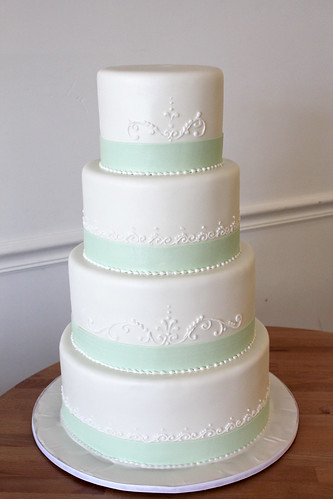 Simple White Wedding Cake with Mint Green Ribbon and Scrollwork