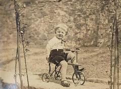 On three Wheels (TrueVintage) Tags: boy childhood 1930s kid child tricycle kind oldphoto foundphoto junge kindheit vintagephoto dreirad vintagekid vintagetricycle vintageboy kinderfahrrad vintagechildhood