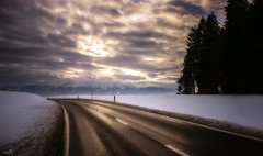 Going Home (VandenBerge Photography) Tags: road travel trees winter sunset sky snow mountains alps nature skyline clouds canon landscape eos schweiz switzerland europe trail lonelyplanet snowscape nationalgeographic winterscape heimenschwand cantonberne