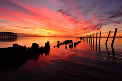 Inferno (santo commarato) Tags: sunset usa water clouds landscape pier nikon rocks bright cloudy decay south urbandecay vivid d800 mobilebay brightsky oldpier sunsetcolors sunsetoverwater santocommarato