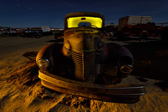 all up in your grille. 2016. (eyetwist) Tags: auto california old longexposure light shadow orange lightpainting west classic dusty car yellow night america truck vintage dark painting photography star nikon rust long exposure glow desert angle decay details transport wide ruin trails rusty pickup wideangle headlights fullmoon moonlit faded bumper american edge highdesert mojave hood moonlight weathered junkyard grille nikkor derelict nocturne wrecked anthropology trucking patina startrails mojavedesert eyetwist npy d7000 capturenx2 eyetwistkevinballuff hollywoodrentals nikond7000 1024mmf3545g