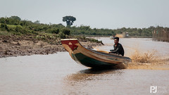 Boating on the Tonle Sap River (philrdjones) Tags: people river boats cambodia fishermen local february tonlesap 2016