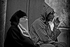 Moroccan (Элвин Ваутерсе) Tags: morocco moroccan couple muslim islam northafrica man woman husband wife smoke smoking cigarette covered face old beard bearded religion tangier elwinw nikon d40 skylinestudio africa glasses specs spectacles ma blackandwhite monochrome