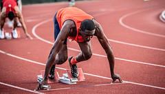 In the blocks. (nataliekrovetz) Tags: man sports race running run charlottesville athlete runner universityofvirginia relay trackandfield competitor trackmeet