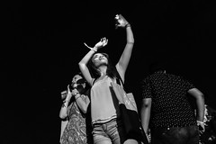 Generation Me. (Presence Inc) Tags: street light portrait people urban bw stilllife festival night 35mm dark photography dance still singapore mood candid sony performance streetphotography nightlife cinematic society crowds nightpeople mirrorless rx1r rx1rm2