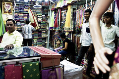 Are you being served? (Mike Foo) Tags: street travel people india shop canon asian asia artistic candid streetphotography indoor clothes fabric bombay mumbai shopkeeper candidphotography travelphotography incredibleindia passionphotography unlimitedphotos canon5dmark3
