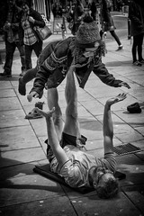 balancing act (Daz Smith) Tags: city uk portrait people urban blackandwhite bw woman man streets blancoynegro monochrome yoga canon blackwhite bath candid citylife thecity streetphotography balancing act lyingdown canon6d dazsmith bathstreetphotography