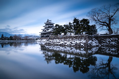 | Matsumoto Castle (dawvon) Tags: longexposure travel winter snow nature water japan architecture reflections season landscape japanese asia shadows cloudy keep moat matsumoto nagano historicalbuilding naganoprefecture honshu  naganoken  matsumotocastle crowcastle     matsumotoj  chbu matsumotoshi karasujo hirajiro flatlandcastle chburegion
