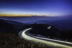 Highway road in the mountain at twilight long exposure at Inthanon Mountain , Chiang Mai , Thailand (armmphoto) Tags: road morning travel blue summer vacation sky cloud sun white mountain tree nature beautiful beauty car misty fog set sunrise point landscape thailand dawn high twilight highway asia day view natural hill foggy scenic landmark scene before fresh trail national valley environment chiangmai tranquil roadway doi inthanon