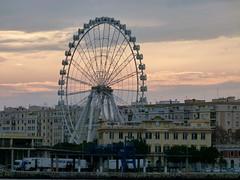 Ferris Wheel at Sundown (Toats Master) Tags: port spain rocks shore ferriswheel malaga