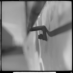 When travelling at the speed of light, hold the handle. (helioshamash) Tags: urban bw 6 white black 6x6 train square los angeles kodak tmax 150 medium format 100 grime rodinal kiev tmx
