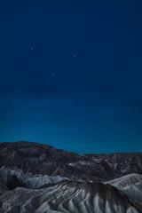 Zabriskie Point at Dawn (lycheng99) Tags: park longexposure travel mountains nature sunrise dark stars landscape dawn nationalpark rocks darkness national deathvalley geology zabriskie zabriskiepoint rockformation deathvalleynationalpark