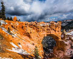 Bryce Canyon 28 (MarcCooper_1950) Tags: trees red sky orange snow colors clouds landscape utah nikon scenery rocks vivid canyon cliffs hills southern boulders hoodoo bryce rainfall hdr formations lightroom mounatins brycecanyonnationalpark geologic d810 marccooper