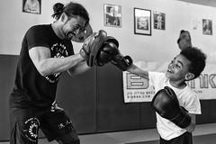 Training (Choukhri Dje) Tags: sport kids training kid gloves glove pao dojo boxing sparring boxe entrainement sportif gant metisse choukhridje