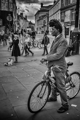 bike man with hair (Daz Smith) Tags: city uk portrait people urban blackandwhite bw streets blancoynegro monochrome bike bicycle canon hair blackwhite bath candid citylife thecity streetphotography singer rider highhair canon6d dazsmith bathstreetphotography