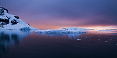 Midnight in the Lemaire Channel _MG_7376 0100 resized (Robyn Aldridge) Tags: sunset seascape mountains colour ice water clouds reflections landscape outdoors rocks wasser outdoor antarctica icefloes coastline channel icebergs waterscape lemaire icescape antarcticpeninsula tamron18270mm
