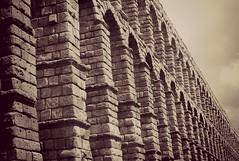 obra maestra (patoche 38) Tags: old bridge espaa history monument stone architecture puente spain pierre monumento aqueduct segovia pont espagne aqueduc acuaducto