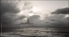 Metallic sea (rhfo2o - rick hathaway photography) Tags: sea sky blackandwhite bw beach clouds sunrise mono seaside waves rustington rustingtonbeach rhfo2o samsunggalaxys6 rustingtonrocks