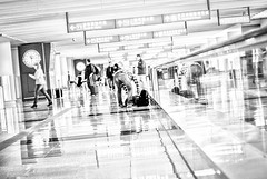 Forgot Something? - Tung Chung, Hong Kong (, ) (dlau Photography) Tags: life city trip travel vacation people urban blackandwhite white black sign airport lifestyle style indoor terminal tourist hong kong international   visitor forgot something soe carryon chung tung
