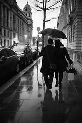 -w  -a  -l  -k (Cem Bayir) Tags: street leica blackandwhite monochrome night umbrella 35mm couple f14 streetphotography bluehour fullframe summilux leicacamera leicam asperical 35mmf14summiluxasph leicaphoto leicam240