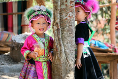 Girls in ethnic costumes, Hmong village near Luang Prabang, Laos (inchiki tour) Tags: travel portrait people girl photo asia southeastasia village embroidery traditional cloth laos ethnic luangprabang hmong stitchwork   louangphrabang