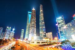 Pudong Power (Andy Brandl (PhotonMix.com)) Tags: urban night digital lights nikon energy cityscape skyscrapers dynamic led processing lighttrails pudong modernarchitecture futuristic orientalpearltower lightbeam swfc shanghaitower fullframephotography photonmix financialdistrictshanghai elevatedpov